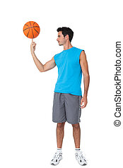 Full length of a basketball player with ball