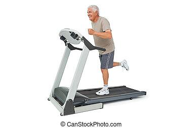 Full length of a senior man running on a treadmill
