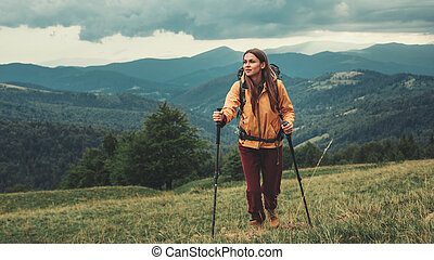 Full length of a sporty woman walking in the mountains