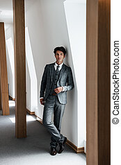 Full length of a successful businessman in suit posing