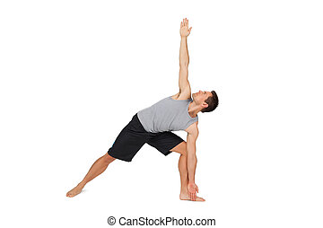 Full length of a young man stretching hand to leg