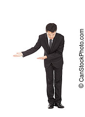 full length of asian businessman with bow and welcome gesture
