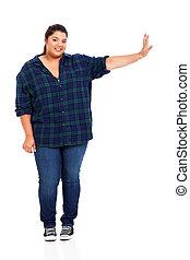 plus size woman pushing on empty copyspace