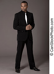 Full length of black american business man on grey background