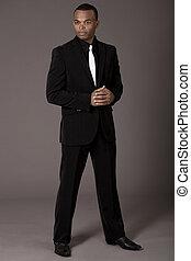 Full length of black american business man on grey ...