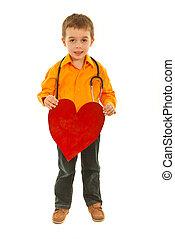 Full length of boy holding heart