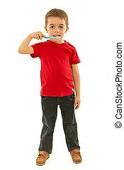 Full length of boy holding toothbrush