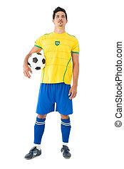 Full length of Brazilian football player over white ...