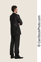 Full length of business man looking at copyspace
