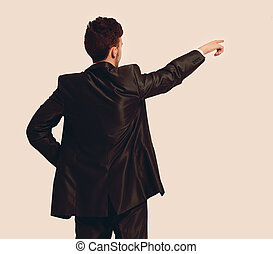 Full length of business man pointing at copyspace