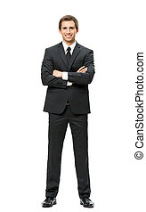 Full-length portrait of business man with hands crossed, isolated. Concept of leadership and success