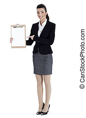 Full length of business woman pointing at the clipboard