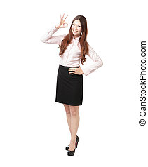 Full length of business woman showing OK hand sign happy smile