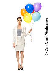 Full length of businesswoman with balloons