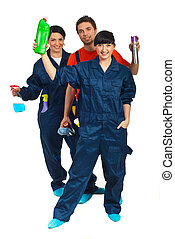 Full length of cleaning workers teamwork - Full length of ...