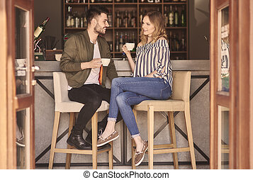 Full length of couple at bar counter
