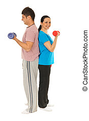 Full length of couple workout