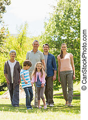 Full length of family walking in park