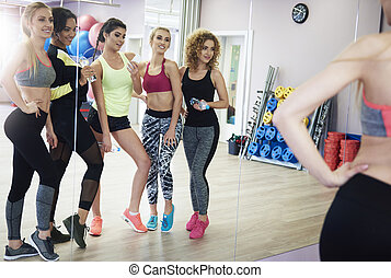 Full length of girls working out