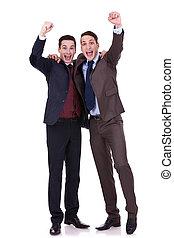 two business men winning