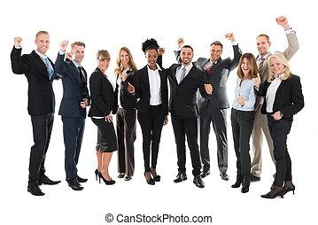 Full Length Of Happy Business Team Celebrating Success