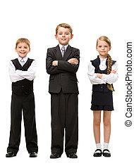 Full length of little children with hands crossed