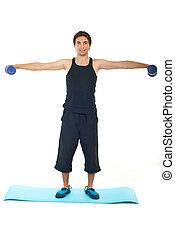 Full length of man lifting barbell