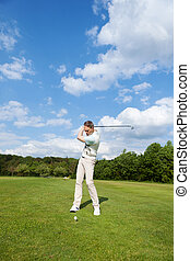 mature man playing golf at course