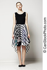 Full Length of Modish Woman in Strippy Dress. Springtime Workday Collection