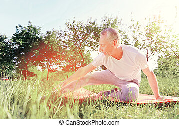 Full length of positive man doing exercises