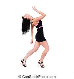 sensual woman wearing a little black dress dancing