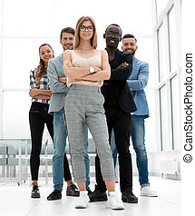 Full length of smiling business people group standing in a row w