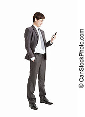 full length of Successful businessman holding smart phone isolated on white