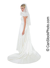 Full length of thoughtful bride in wedding dress