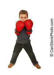 Full length of upset boxer child boy