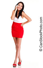 Full length of woman walking talking on mobile phone isolated