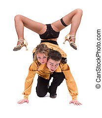 Full length of young ballet couple dancing against isolated...