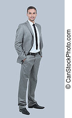 Full length of young successful manager smiling isolated on gray