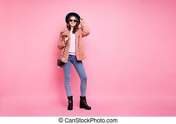Full length photo of adorable millennial lady going street watching sightseeing wear stylish jacket jeans shoulder bag sun specs hat isolated pink background