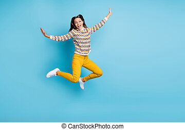 Full length photo of adorable sweet young woman dressed ornament pullover jumping copyspace isolated blue color background.