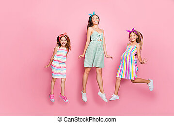 Full length photo of charming three people jumping wearing headbands skirt dress isolated over pink background