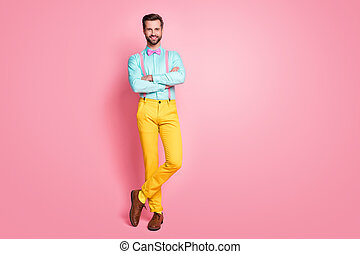 Full length photo of handsome guy trend clothes red carpet celebrity arms crossed photographing posing wear shirt suspenders bow tie yellow pants shoes isolated pastel pink color background