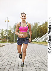 Full length photo of jogging woman