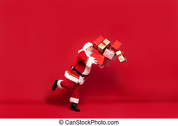 Santa Claus with a lot of gifts on a red background.