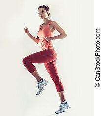 full-length photo of running woman over white background