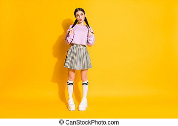 Full length photo sweet lovely girl hold tails look copyspace think thouhts, guess imagine her date plans send air kiss wear jumper plaid clothes isolated bright shine color background