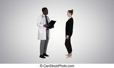 Physician showing a patient the X-ray results Then patient leaves on gradient background.