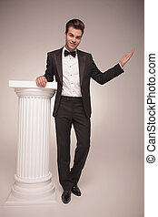 Full length picture of a handsome elegant business man