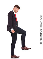 business man stepping on something