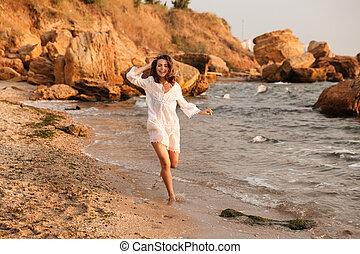 Full-length picture of happy brunette woman in light summer dress